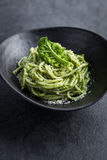 Spaghetti pasta with  kale pesto sauce and parmesan cheese Stock Photo
