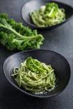 Spaghetti pasta with  kale pesto sauce and parmesan cheese Royalty Free Stock Image