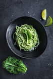 Spaghetti pasta with  kale pesto sauce and parmesan cheese Royalty Free Stock Photography