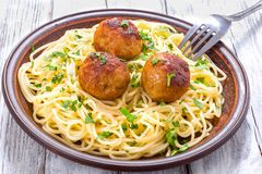 Spaghetti pasta with meatballs sprinkled with chopped parsley , top view Royalty Free Stock Images