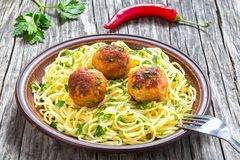 Spaghetti pasta with meatballs sprinkled with chopped parsley , top view Royalty Free Stock Photos