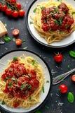 Spaghetti pasta meatballs with tomato sauce, basil, herbs parmesan cheese on dark background Stock Photo