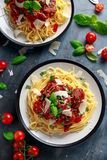 Spaghetti pasta meatballs with tomato sauce, basil, herbs parmesan cheese on dark background Royalty Free Stock Photos