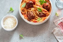 Spaghetti with meatballs and tomato sauce Stock Photos