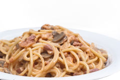 Spaghetti pasta with mushrooms sauce isolated Stock Photography