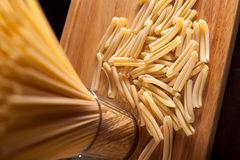 Spaghetti pasta over wooden background Stock Images