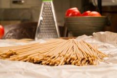 Spaghetti pasta on paper in the kitchen Stock Photos