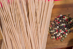 Spaghetti pasta with pepper on a wooden board Stock Images