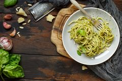 Spaghetti pasta with pesto sauce. Basil, pine nuts and parmesan close up stock images