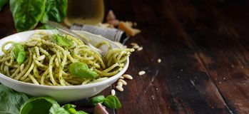 Spaghetti pasta with pesto sauce. Basil, pine nuts and parmesan close up royalty free stock images