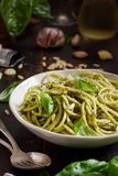 Spaghetti pasta with pesto sauce stock photo