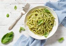 Spaghetti pasta with pesto sauce. Basil, pine nuts and parmesan close up royalty free stock image