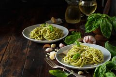 Spaghetti pasta with pesto sauce. Basil, pine nuts and parmesan close up royalty free stock photo