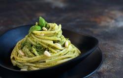 Spaghetti pasta with pesto sauce. Basil, pine nuts and parmesan close up stock image