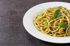Spaghetti pasta with pesto sauce. On black background. Copy space royalty free stock photos