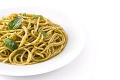 Spaghetti pasta with pesto sauce. Isolated on white background royalty free stock image