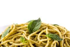 Spaghetti pasta with pesto sauce isolated. On white background. Copyspace royalty free stock photo