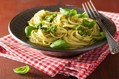 Spaghetti pasta with pesto sauce over rustic table Royalty Free Stock Image