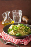 Spaghetti pasta with pesto sauce over rustic table Royalty Free Stock Photo
