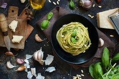 Spaghetti pasta with pesto sauce. Basil, pine nuts and parmesan close up royalty free stock photos