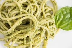 Spaghetti pasta with pesto sauce in white dish, background. Spaghetti pasta with pesto sauce in white dish, closeup  background Stock Image