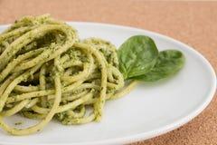 Spaghetti pasta with pesto sauce in white dish, closeup  background. Spaghetti pasta with pesto sauce in white dish, closeup  background Stock Photos