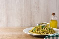 Spaghetti pasta with pesto sauce on wood. En table. Copyspace royalty free stock images