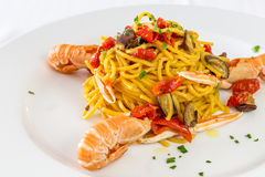 Spaghetti pasta with prawns and tomatoes. Dish of spaghetti pasta with prawns and tomatoes stock images