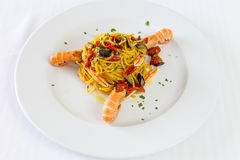 Spaghetti pasta with prawns and tomatoes. Gourmet restaurant seafood Royalty Free Stock Photography