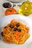 Spaghetti pasta puttanesca. Spaghetti pasta with fresh home made puttanesca sauce royalty free stock images