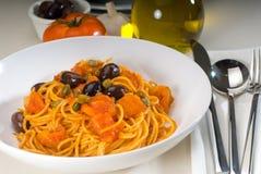Spaghetti pasta puttanesca. Spaghetti pasta with fresh home made puttanesca sauce stock photography