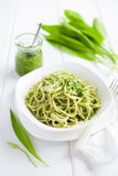 Spaghetti pasta with  ramson (wild garlic) pesto Royalty Free Stock Image