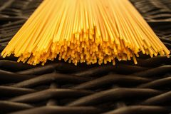Spaghetti pasta raw black background royalty free stock images