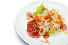 Spaghetti pasta with sausage on white background,clipping path Royalty Free Stock Photo