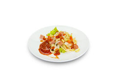 Spaghetti pasta with sausage on white background,clipping path Royalty Free Stock Images