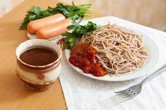 Spaghetti pasta and sausages Royalty Free Stock Image