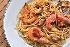 Spaghetti pasta with seafood. Italian recipe: spaghetti and seafood Stock Photos