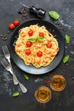 Spaghetti pasta with shrimps and white wine on a dark stone background. Top view.  royalty free stock photos