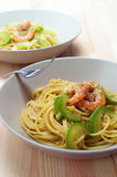 Spaghetti pasta with shrimps and zucchini sauce Stock Photos
