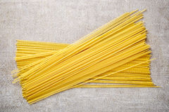 Spaghetti pasta on stone table, from above Stock Photo