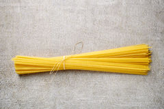 Spaghetti pasta on stone table, from above Royalty Free Stock Images