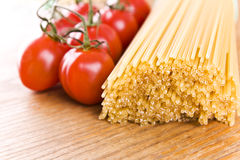 Spaghetti pasta and sweet little tomatos Royalty Free Stock Photography