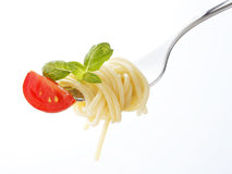 Spaghetti pasta with tomato and basil on fork Stock Images