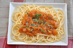 Spaghetti pasta with tomato sauce Stock Images