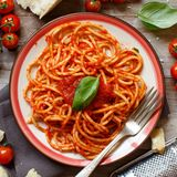 Spaghetti pasta with tomato sauce. Basil and cheese on a wooden table stock image