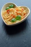 Spaghetti pasta with tomato sauce and garnish Royalty Free Stock Image