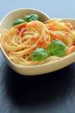 Spaghetti pasta with tomato sauce and garnish Stock Photo