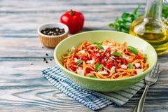 Spaghetti pasta with tomato sauce, mozzarella cheese and fresh basil leaves on white-blue vintage wooden background royalty free stock photos