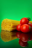 Spaghetti pasta with tomatoes and basil. Bunch of spaghetti pasta with fresh tomatoes and basil Royalty Free Stock Photo