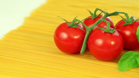 Spaghetti pasta tomatoes and basil, italian food background stock footage